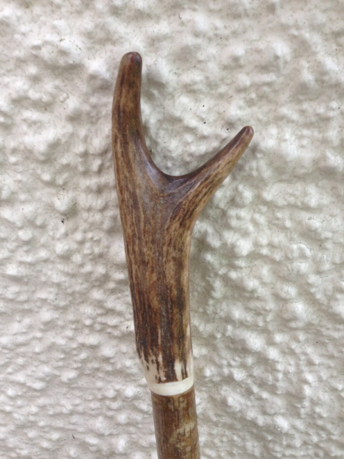 Red deer antler thumb stick with white bone spacer
